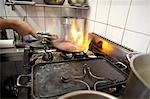 Shooting flame while frying meat in the kitchen Stock Photo - Premium Royalty-Free, Artist: Photocuisine, Code: 659-03535238