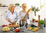 Women having a laugh while cooking spaghetti Stock Photo - Premium Royalty-Free, Artist: Aflo Relax, Code: 659-03535424