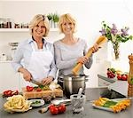 Women having a laugh while cooking spaghetti Stock Photo - Premium Royalty-Free, Artist: Aflo Relax, Code: 659-03535425