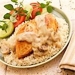 Chicken Breast with Mushroom Sauce over Rice; Tomato Cucumber Salad Stock Photo - Premium Royalty-Free, Artist: Westend61, Code: 659-03536177