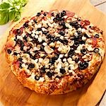 Pizza with Onions, Mushrooms, Olives and Pepperoni Stock Photo - Premium Royalty-Free, Artist: Westend61, Code: 659-03536183