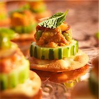 Chicken Tikka Amuse Bouche on Cucumber and Cracker Stock Photo - Premium Royalty-Freenull, Code: 659-03536196