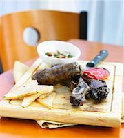 Argentinian Steak with Grilled Red Pepper and Chimichurri Sauce Stock Photo - Premium Royalty-Freenull, Code: 659-03536429