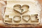 Biscuit cutters for 'LOVE' biscuits on dough Stock Photo - Premium Royalty-Free, Artist: Transtock, Code: 659-03536701