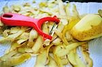 Potato peeler with potato peelings and potato Stock Photo - Premium Royalty-Free, Artist: foodanddrinkphotos, Code: 659-03536878