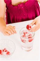 Girl holding a raspberry ice cube in her hand Stock Photo - Premium Royalty-Freenull, Code: 659-03536937
