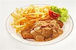 Pork escalope with chips and mushroom sauce Stock Photo - Premium Royalty-Free, Artist: Westend61, Code: 659-03536982