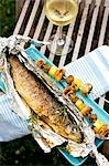 Barbecued trout with mushroom and potato skewers Stock Photo - Premium Royalty-Free, Artist: Westend61, Code: 659-03537205