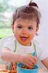 Girl eating pasta with bolognese sauce Stock Photo - Premium Royalty-Free, Artist: Aflo Sport               , Code: 659-03537373
