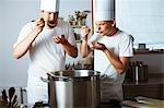 Two chefs tasting soup out of pan Stock Photo - Premium Royalty-Free, Artist: Photocuisine, Code: 659-03537663