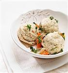 Matzah Balls with Carrots and Parsley in a White Bowl Stock Photo - Premium Royalty-Free, Artist: foodanddrinkphotos, Code: 659-03537705
