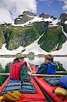 Two female kayakers resting along coast Aialik Bay Kenai Fjords National Park Alaska Spring Stock Photo - Premium Rights-Managed, Artist: AlaskaStock, Code: 854-03538076
