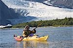 Man sea kayaking in Aialik Bay with Pederson Glacier in the background in Kenai Fjords National Park Stock Photo - Premium Rights-Managed, Artist: AlaskaStock, Code: 854-03538081