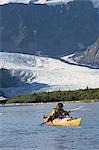 Man sea kayaking in Aialik Bay with Pederson Glacier in the background in Kenai Fjords National Park Stock Photo - Premium Rights-Managed, Artist: AlaskaStock, Code: 854-03538082