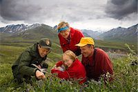 Native Indian US Park Service Ranger shows a family wildflowers on tundra on nature walk Denali National Park Alaska Stock Photo - Premium Rights-Managednull, Code: 854-03538117