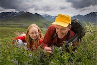 Native Indian US Park Service Ranger shows a family wildflowers on tundra on nature walk Denali National Park Alaska Stock Photo - Premium Rights-Managednull, Code: 854-03538118