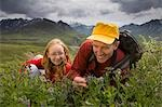 Native Indian US Park Service Ranger shows a family wildflowers on tundra on nature walk Denali National Park Alaska Stock Photo - Premium Rights-Managed, Artist: AlaskaStock, Code: 854-03538118