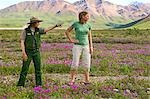 Female US Interpretive Ranger shows a female  tourist the view at Toklat River in Denali National Park Alaska Stock Photo - Premium Rights-Managed, Artist: AlaskaStock, Code: 854-03538127