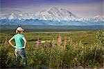 Female visitor views Mt.Mckinley & Alaska Range through binoculars next to fireweed flowers Denali National Park Alaska Stock Photo - Premium Rights-Managed, Artist: AlaskaStock, Code: 854-03538129