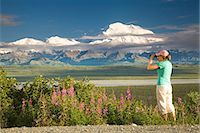 Young woman tourist views Mt.McKinley and the Alaska Range in Denali National Park Alaska summer Stock Photo - Premium Rights-Managednull, Code: 854-03538133