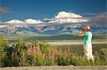Young woman tourist views Mt.McKinley and the Alaska Range in Denali National Park Alaska summer Stock Photo - Premium Rights-Managed, Artist: AlaskaStock, Code: 854-03538133