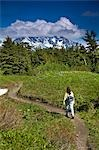 Woman hiking in meadow of wildflowers with Kenai Mountains in background along Lost Lake Trail near Seward, Alaska during Summer Stock Photo - Premium Rights-Managed, Artist: AlaskaStock, Code: 854-03538187