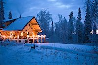 Log Cabin in the woods decorated with Christmas lights at twilight near Fairbanks, Alaska during Winter Stock Photo - Premium Rights-Managednull, Code: 854-03538490