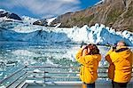 Tourist couple on a Klondike Express Glacier Cruise tour view Stairway glacier (r) flowing into Surprise Glacier Harriman Fjord, Alaska Stock Photo - Premium Rights-Managed, Artist: AlaskaStock, Code: 854-03538546