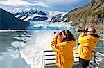 Tourist couple on a Klondike Express Glacier Cruise tour view Stairway glacier (r) flowing into Surprise Glacier Harriman Fjord, Alaska Stock Photo - Premium Rights-Managed, Artist: AlaskaStock, Code: 854-03538549