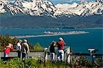 Tourists take pictures of the view of the Homer Spit, Kachemak Bay and the Kenai Mountains from the Baycrest Overlook on the Sterling Highway, Alaska Stock Photo - Premium Rights-Managed, Artist: AlaskaStock, Code: 854-03538598