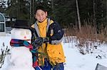 Alaskan native boy with snowman outside winter Alaska Inupiat Eskimo Stock Photo - Premium Rights-Managed, Artist: AlaskaStock, Code: 854-03538833