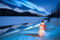 Lighted snowman decoration standing on riverbank Alaska Winter Composite Stock Photo - Premium Rights-Managednull, Code: 854-03538977