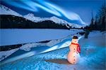 Lighted snowman decoration standing on riverbank Alaska Winter Composite Stock Photo - Premium Rights-Managed, Artist: AlaskaStock, Code: 854-03538977