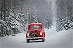 Man driving a vintage 1941 Ford pickup with a Christmas wreath on the front during Winter in Southcentral, Alaska Stock Photo - Premium Rights-Managed, Artist: AlaskaStock, Code: 854-03538999