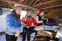 Three young women collect and pile chopped wood near Homer, Alaska during winter. Stock Photo - Premium Rights-Managednull, Code: 854-03539094