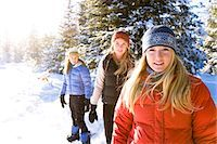 Three young women on snowshoes enjoy the outdoors near Homer, Alaska during winter. Stock Photo - Premium Rights-Managednull, Code: 854-03539095