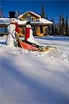Large & small snowman ride on dog sled in deep snow in afternoon in front of log cabin style home Fairbanks Alaska winter Stock Photo - Premium Rights-Managed, Artist: AlaskaStock, Code: 854-03539268