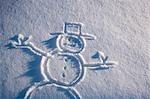 Drawing of snowman in new fresh snow Alaska winter