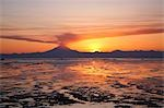 Ash cloud rises from Mt. Redoubt at sunset during low tide near Ninilchik, Alaska Stock Photo - Premium Rights-Managed, Artist: AlaskaStock, Code: 854-03539313