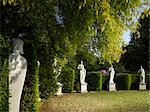 Chiswick House and Gardens, Chiswick. Exedra, a lawn lined by alternating cypresses and stone urns closed by a semicircular dark yew hedge, forming a backdrop to Lord Burlington's collection of ancient Roman and 18th century sculpture.  Architects: The Third Earl of Burlington with William Kent Stock Photo - Premium Rights-Managed, Artist: Arcaid, Code: 845-03553261