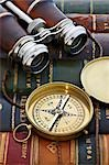 Close-up of Compass and Binoculars on Leather Bound Books Stock Photo - Premium Rights-Managed, Artist: David Muir, Code: 700-03553413