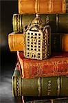 Close-up of Antique Coin Bank on Leather Bound Books Stock Photo - Premium Rights-Managed, Artist: David Muir, Code: 700-03553426