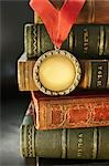 Close-up of Golden Medal with Leather Bound Books Stock Photo - Premium Rights-Managed, Artist: David Muir, Code: 700-03553432