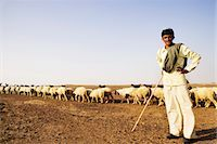 Portrait of a shepherd standing with arms akimbo, Jaisalmer, Rajasthan, India Stock Photo - Premium Rights-Managednull, Code: 857-03553592
