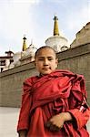 Child monk standing in front of a monastery, Lamayuru Monastery, Ladakh, Jammu and Kashmir, India Stock Photo - Premium Rights-Managed, Artist: Photosindia, Code: 857-03553763