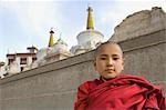 Child monk standing in front of a monastery, Lamayuru Monastery, Ladakh, Jammu and Kashmir, India Stock Photo - Premium Rights-Managed, Artist: Photosindia, Code: 857-03553764