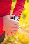 Woman Setting Timer on Watch Stock Photo - Premium Rights-Managed, Artist: Ty Milford, Code: 700-03554438