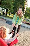 Mother Pushing Daughter on Swing in Green Lake Park in Autumn, Seattle, Washington, USA Stock Photo - Premium Rights-Managed, Artist: Ty Milford, Code: 700-03554477