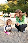 Mother and Daughter in Sandbox in Green Lake Park in Autumn, Seattle, Washington, USA Stock Photo - Premium Rights-Managed, Artist: Ty Milford, Code: 700-03554483