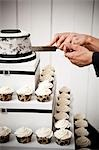 Bride and Groom Slicing Wedding Cake Stock Photo - Premium Rights-Managed, Artist: Ikonica, Code: 700-03556749